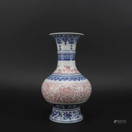 An underglaze-blue and copper-red 'floral' vase