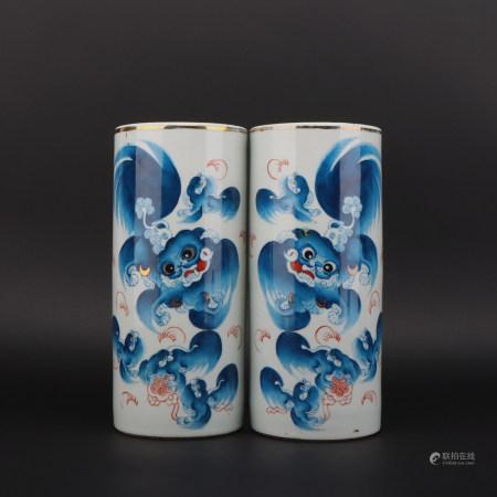 A pair of blue glazed vase