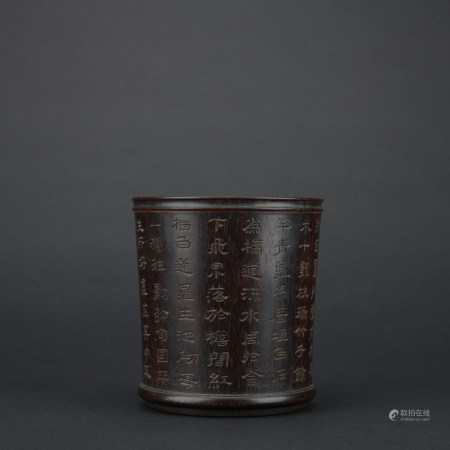 A wood pen container with poems pattern