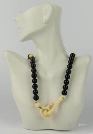 CHINESE ONYX AND CARVED BEADED NECKLACE HORSE