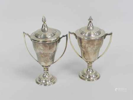 A near pair of silver trophy cups and covers