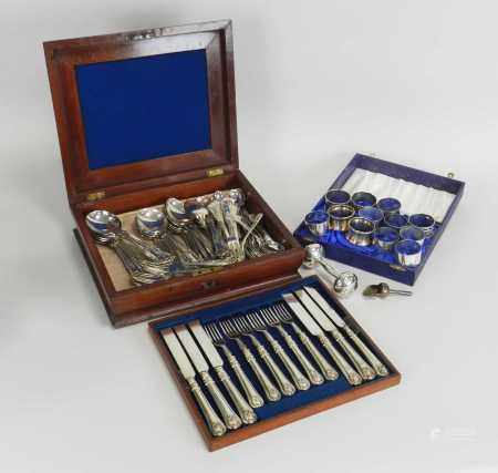 A set of twelve Victorian silver handled knives and forks