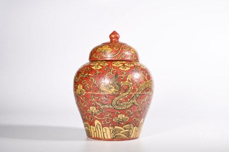 AN IRON GROUND YELLOW DRAGON PORCELAIN JAR AND COVER