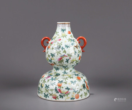 A FAMILLE ROSE BUTTERFLY AND FLOWER PORCELAIN GOURD-SHAPED VASE