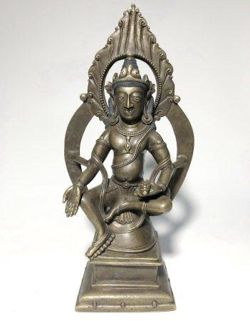A GILT-BRONZE INLAID GEM FIGURE OF BUDDHA