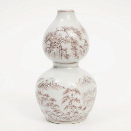 A red-glazed gourd vase with landscape figures, Qianlong period, Qing Dynasty 清乾隆釉里红山水人物纹葫芦瓶
