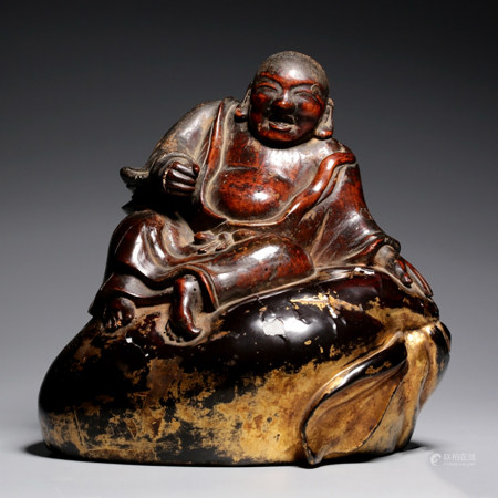 A GOLD LACQUER WOOD CARVED MONK ORNAMENT
