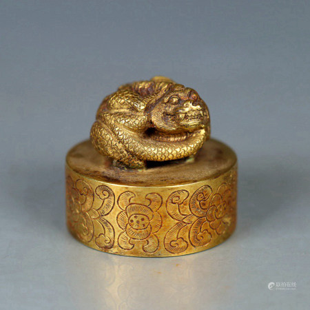 A GILD BRONZE BEAST HANDLE SEAL