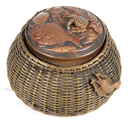 A JAPANESE MEIJI PERIOD NOVELTY INKWELL modelled as a basket of fish with a woven brass basket and
