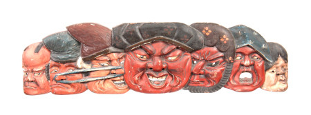 A 19th CENTURY JAPANESE CARVED WOOD AND LACQUER WALL PANEL depicting seven faces of Japanese