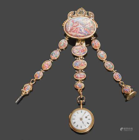 - Châtelaine en or jaune 750°/°° (tête d'aigle) à décors ajourés de feuillages et de miniatures