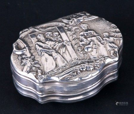 A continental silver snuff box with shell back and ornate figural scene to the front. 6cm ( 2.25