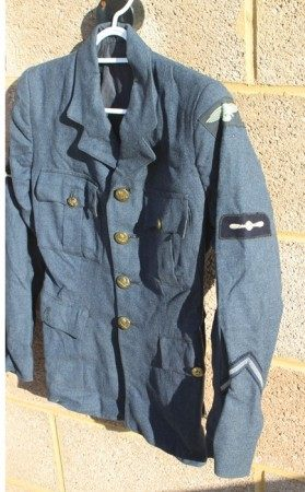 An extremely rare WW2 Womens Auxiliary Air Force (WAAF) Jacket with original cloth badges and