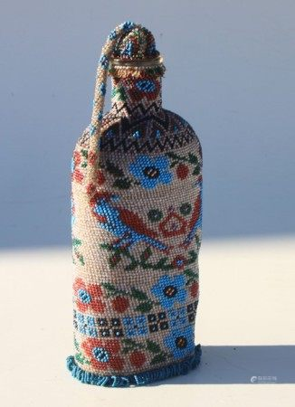 A Boer War 1901 dated Prisoner of War art bead covered bottle with stopper. Overall height 23cms (