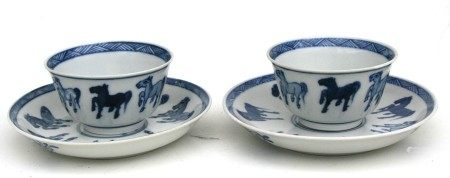 Two Chinese blue & white tea bowls and saucers decorated with the Horses of Mu.