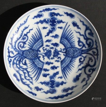 A Chinese blue & white shallow dish decorated with a phoenix amongst clouds, six character blue mark