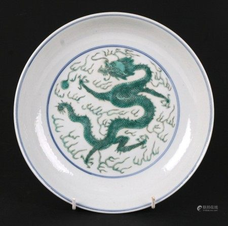 A Chinese famille vert shallow dish decorated with dragons chasing a flaming pearl, blue seal mark