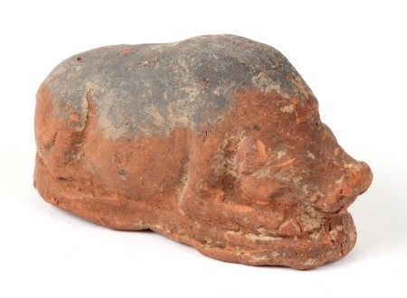 A Chinese burial terracotta and painted boar, 10cms (4ins) long.