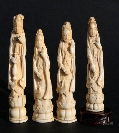 Four 19th century Japanese ivory figures in the form of Kannon on lotus bases, each 18cms (7ins)
