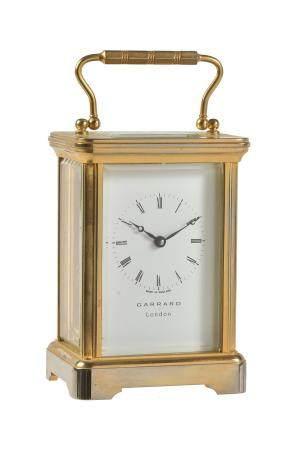 An English gilt brass carriage timepiece