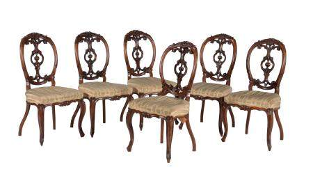 A set of six Victorian carved walnut side chairs