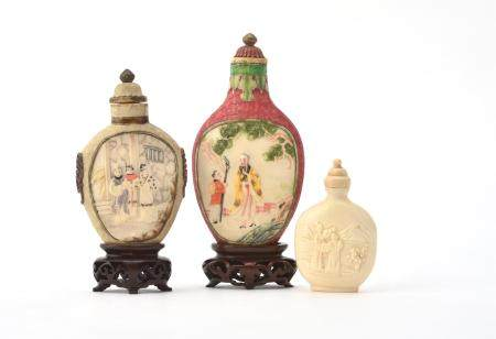 Y Two Chinese stained ivory snuff bottles