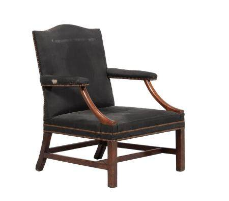 A mahogany and upholstered armchair in George III style