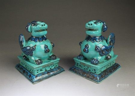 A Pair of Porcelain Mythical Beast Figurines