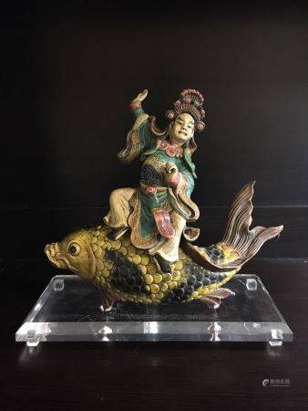 A Wucai Pottery Figurine