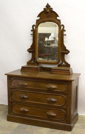 A Mirrored Back Vanity Dresser