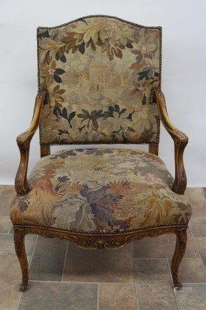 An Antique Open Arm Chair