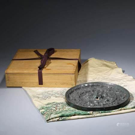 A CHINESE BRONZE GRAPE MIRROR