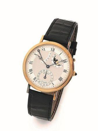 BREGUET  N° 1316A Vers 1990  Montre bracelet en or jaune 18k (750) avec quantième, réserve de m