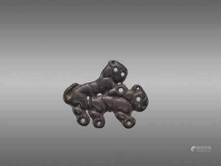 AN ORDOS BRONZE 'COPULATING TIGERS' PLAQUE, WARRING STATES