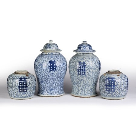 Two similar blue and white baluster lidded vases Chinese, 19th Century, decorated to the body with