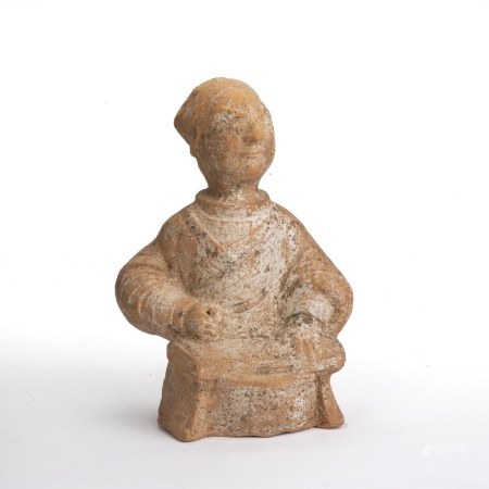 Pottery figure of an immortal Chinese, Han Dynasty, in a seated position with robes around his waist