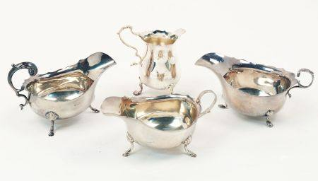 A pair of silver sauce boats, Birmingham, c.1923, S. Blanckensee & Son Ltd., both with scalloped