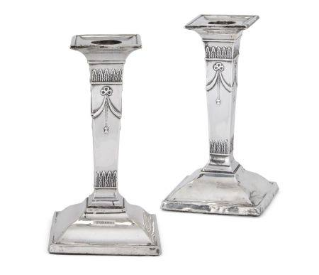 A pair of silver candlesticks, Sheffield, c.1910, Fordham & Faulkner, of short, columnar form, the