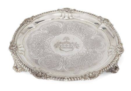 A George IV silver salver, London, c.1823, Joseph Craddock & William Ker Reid, raised on three shell