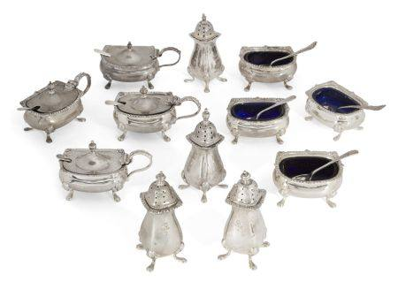 A matched set of silver cruets, comprising four each peppers, salts and mustard pots, various