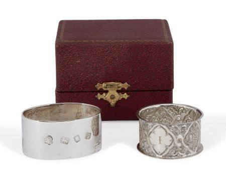 A silver napkin ring in fitted case, London, c.1973, CJ Vander Ltd., of plain flattened oval form,