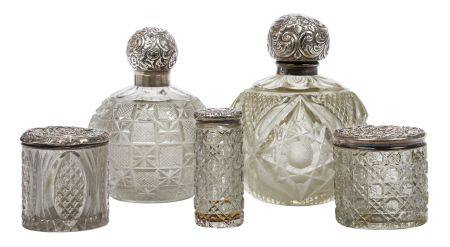 Five silver mounted cut glass vessels, comprising two globular bottles with glass stoppers and