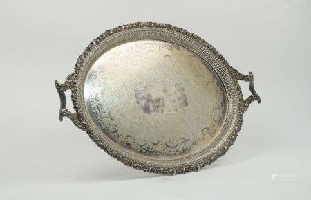 A very large silver plated fish platter, of extended oval form with reed and foliate edge, a