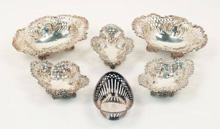 Six pierced silver bonbon dishes, the largest pair London, c.1892 & 1893, Sibray, Hall & Co (marks