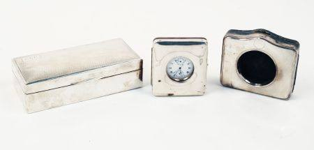 A silver cigarette box, Birmingham, c.1927, Deakin & Francis, of rectangular form with wood-lined