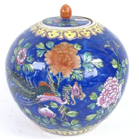 A Chinese famille rose phoenix ginger jar and cover, blue ground with floral decoration and 4