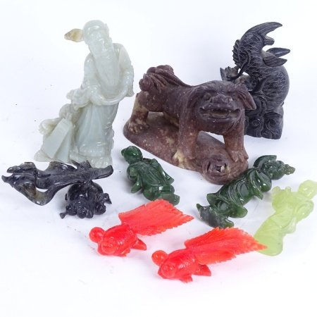 A group of Oriental hardstone carved figures, including soapstone kylin, jadeite Guanyin etc,