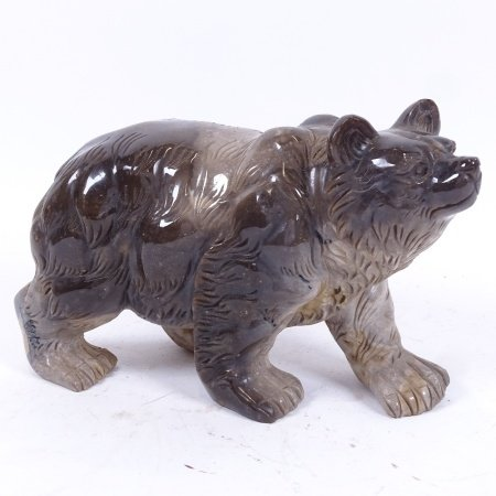 A large grey soapstone grizzly bear figure, length 21cm