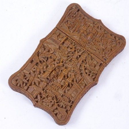A 19th century Chinese Canton sandalwood card case, relief carved village decoration, length 10.5cm