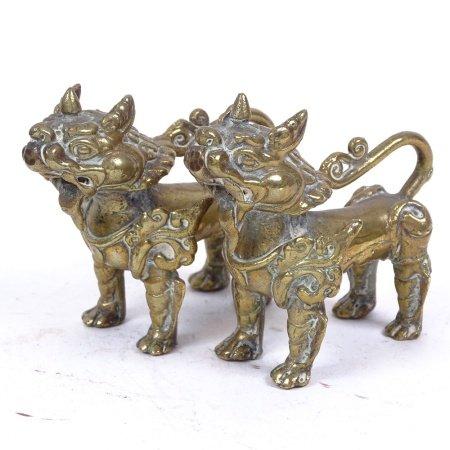 A pair of 19th century Tibetan bronze temple lions, length 9.5cm